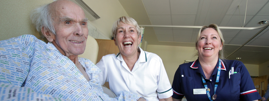 nurses and older male patient